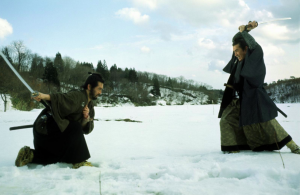Magobei (Tatsuya Nakadai) and Tatewaki (Tetsurô Tanba) fight during their spectacular climactic duel in the snow