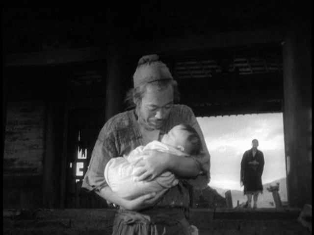 The Woodcutter (Takashi Shimura) is redeemed, walking home with the baby as the rain stops, the sun breaks through and the film comes to an end.