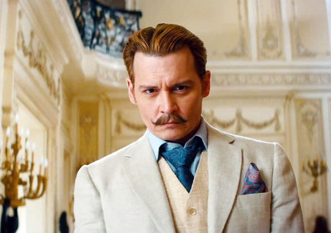 mortdecai-2-johnny-depp-shows-off-a-side-we-haven-t-seen-from-him-johnny-depp-s-mortdecai-strange-dark-jay-gatsby-like-moron